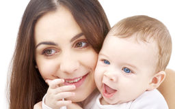 Smiling baby in mother hands #2 Royalty Free Stock Image