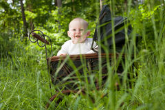 Smiling baby in nature stock photo