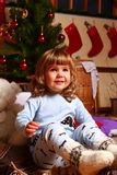 Smiling baby near Christmas tree Royalty Free Stock Image