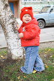 Smiling baby near tree. Smiling baby in red shirt stay near tree Stock Photography