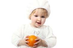 Smiling baby with orange isolated on white Stock Photos