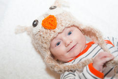 Smiling Baby in Owl Hat Stock Image