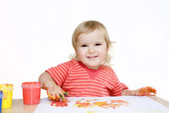 Smiling baby painting with finger Stock Photos