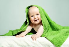 Smiling Baby, Parental Care Stock Images