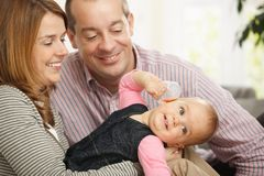 Smiling baby with parents Stock Images