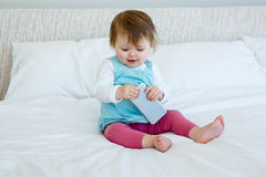 Smiling baby playing with a mobile  phone Royalty Free Stock Photo