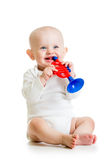 Smiling baby playing with musical toy on white backgro Stock Photo