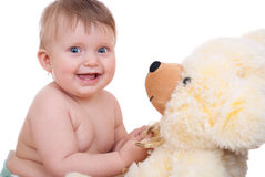 Baby playing with teddy bear Stock Photography