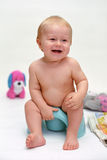 Smiling baby on potty Royalty Free Stock Photography