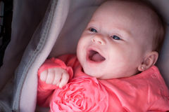 Smiling baby in the pram Stock Image