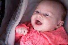 Smiling baby in the pram Stock Image
