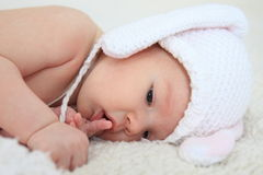 Smiling baby in rabbit costume. Smiling  baby in rabbitstyle hat Stock Images