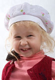Smiling baby with rat Stock Images