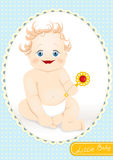 Smiling baby with a rattle Royalty Free Stock Photography