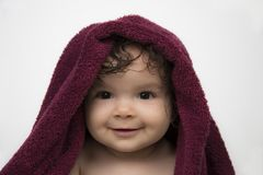 Smiling baby in red bath towel stock images