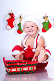 Smiling baby Santa Claus with Christmas basket Royalty Free Stock Image