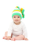 Smiling baby sitting on bed Royalty Free Stock Photos