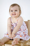 Smiling baby sitting on the chair Royalty Free Stock Images