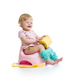 Smiling baby sitting on chamber pot Royalty Free Stock Photos