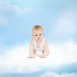 Smiling baby sitting on the cloud Stock Photography