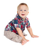 Smiling baby sitting on the floor Royalty Free Stock Images