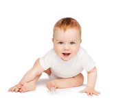 Smiling baby sitting on the floor Royalty Free Stock Image