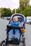 Smiling baby in sitting stroller #12 Royalty Free Stock Photo