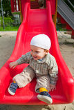 Smiling baby on slide Royalty Free Stock Images