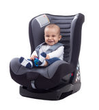 Smiling baby smiling and keep safe in car seat Royalty Free Stock Photography