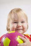 Smiling baby with soccer ball Royalty Free Stock Photos