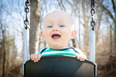 Smiling Baby Swinging Stock Photos