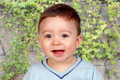 Smiling baby with tears in his eyes Royalty Free Stock Photography