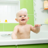 Smiling baby toddler taking bath Stock Photo