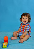 Smiling baby with train Stock Images