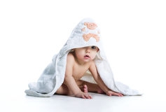 Smiling baby under the towel Royalty Free Stock Image