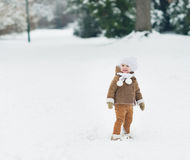 Smiling baby walking in winter park Royalty Free Stock Photos