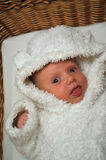 Smiling baby in white bear clothes Stock Images