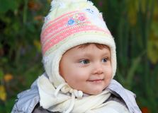 Smiling baby in white hat outdoor royalty free stock photography