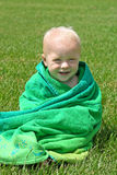 Smiling Baby Wrapped in Beach Towel Stock Images