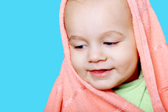 Smiling baby wrapped in a pink towel Royalty Free Stock Photography