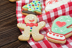 Smiling on the background of Christmas gingerbread Royalty Free Stock Photos