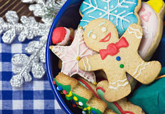 Smiling on the background of Christmas gingerbread decorations Royalty Free Stock Image