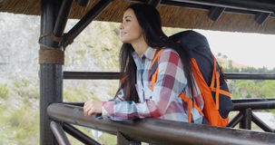 Smiling backpacker on a mountain lookout Stock Photography