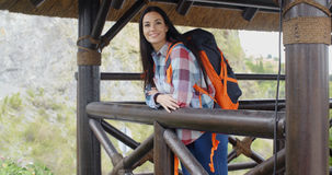 Smiling backpacker on a mountain lookout Stock Image
