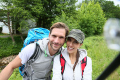 Smiling backpackers making selfie Stock Photo