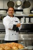 Smiling baker Stock Image