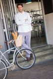 Smiling baker with arms crossed and bike Stock Photos