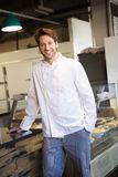 Smiling baker leaning on counter Stock Photos