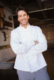 Smiling baker standing with arms crossed Royalty Free Stock Photo