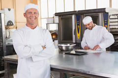 Smiling baker standing with arms crossed Royalty Free Stock Image